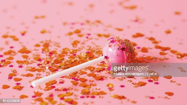 Close-Up Of Candy Over Pink Background