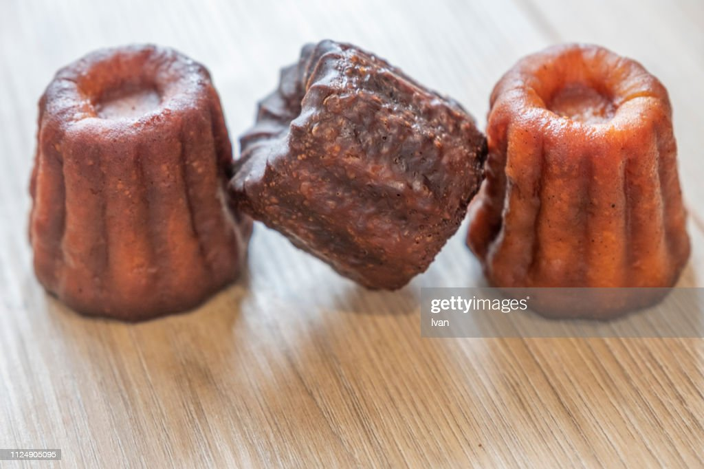 Close-up of canele cakes in a row : Stock Photo