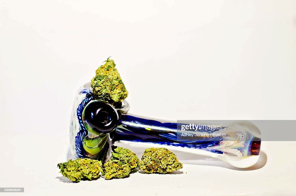 closeup of cannabis with pipe against white background ストック