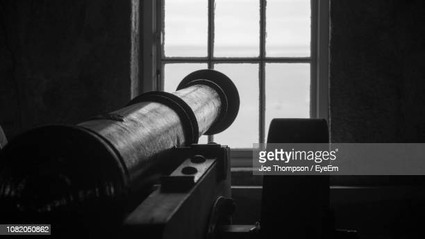 Close-Up Of Cannon By Window
