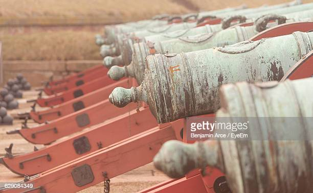 Close-Up Of Cannons In Row