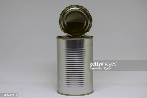 close-up of cans over white background - tin can stock pictures, royalty-free photos & images