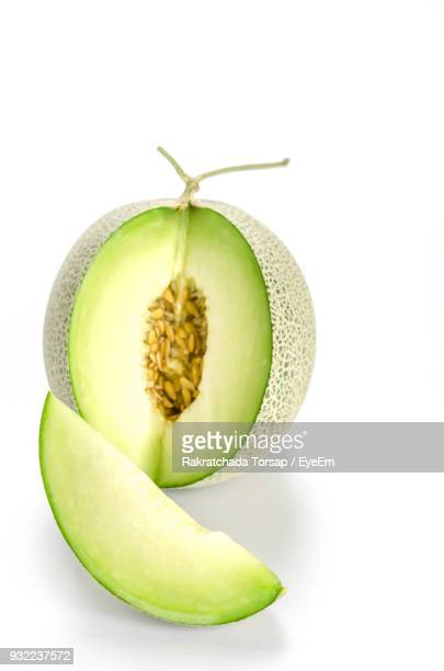 close-up of cantaloupe against white background - muskmelon stock pictures, royalty-free photos & images