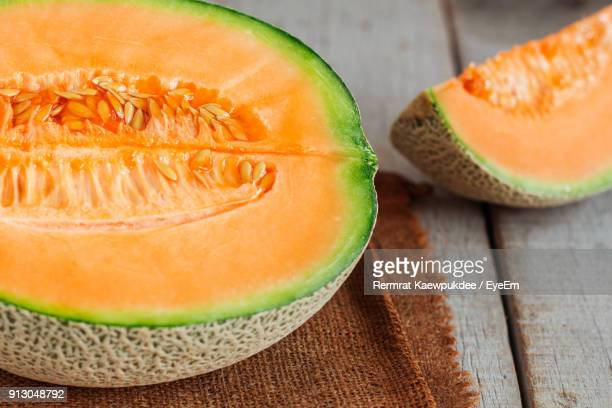 close-up of cantaloupe on table - muskmelon stock pictures, royalty-free photos & images
