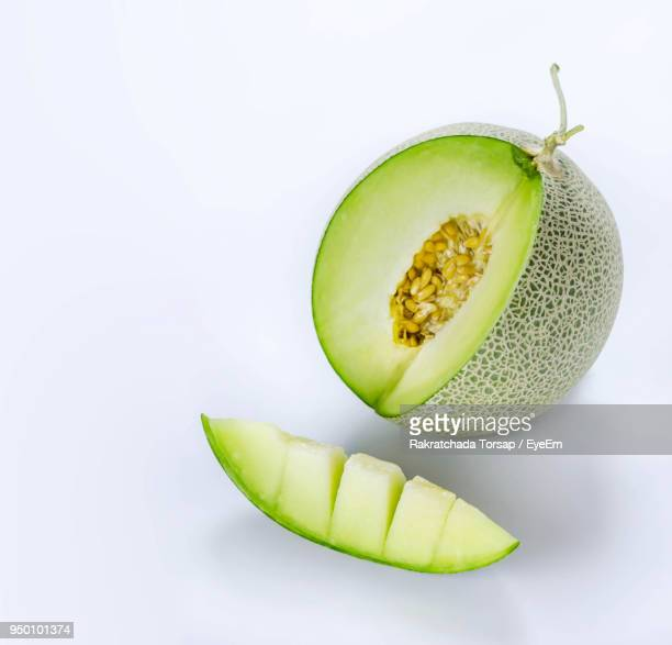close-up of cantaloupe over white background - muskmelon stock pictures, royalty-free photos & images