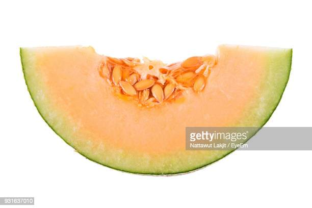 Close-Up Of Cantaloupe Slice Against White Background
