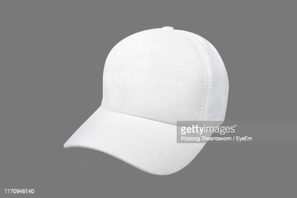 close-up of cap against gray background - cap stock pictures, royalty-free photos & images