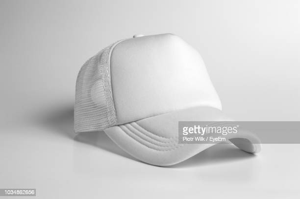 close-up of cap against white background - cappello foto e immagini stock