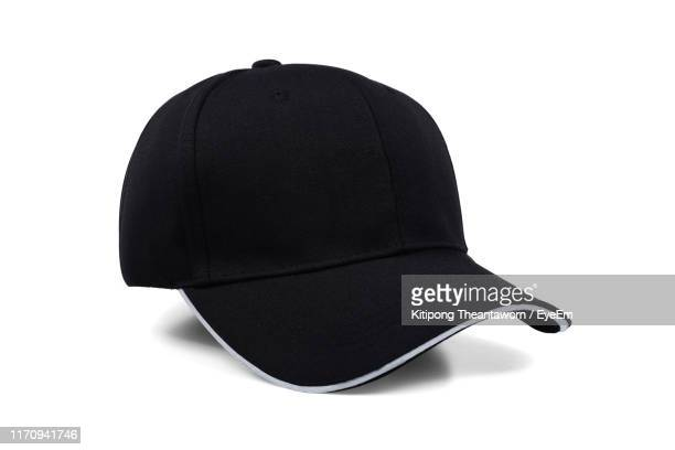 close-up of cap against white background - cap stock pictures, royalty-free photos & images