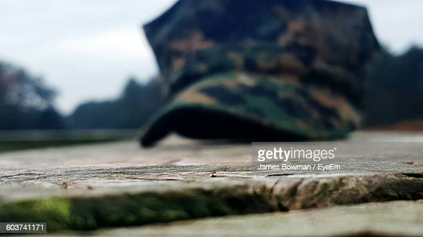 close-up of cap on floor - uniform cap stock pictures, royalty-free photos & images