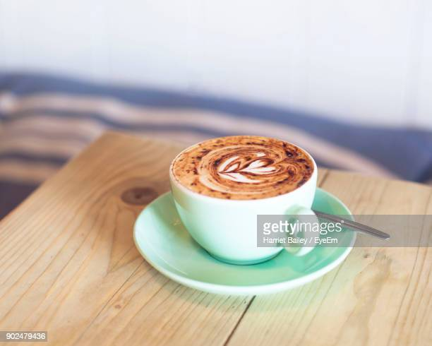 close-up of cappuccino on table - harriet stock photos and pictures
