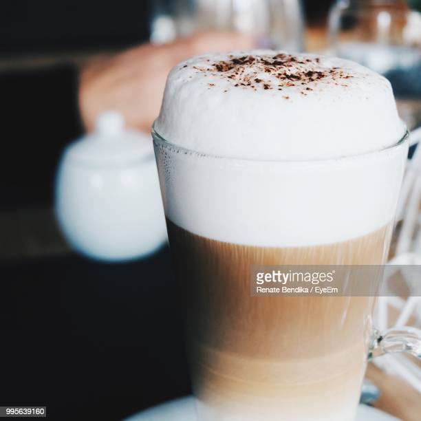 close-up of cappuccino on table - frothy drink stock pictures, royalty-free photos & images
