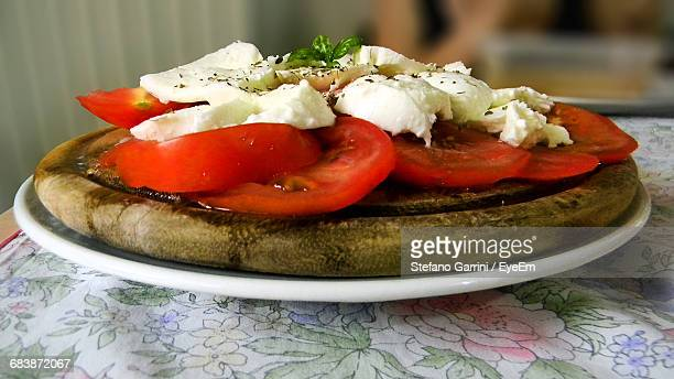 Close-Up Of Caprese Salad In Plate On Table