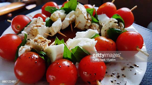 Close-Up Of Caprese Salad Served On Table