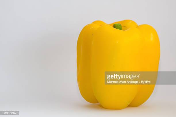 close-up of capsicum over white background - yellow bell pepper stock pictures, royalty-free photos & images