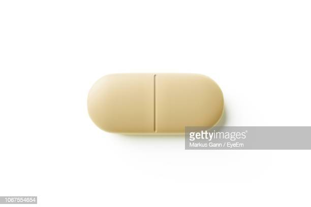 close-up of capsule over white background - pill stock pictures, royalty-free photos & images