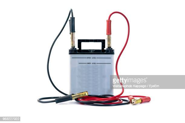 close-up of car battery against white background - battery stock photos and pictures