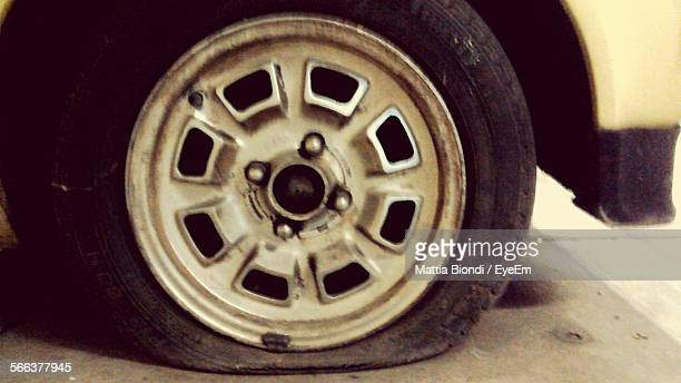 Close-Up Of Car Flat Tire On Street