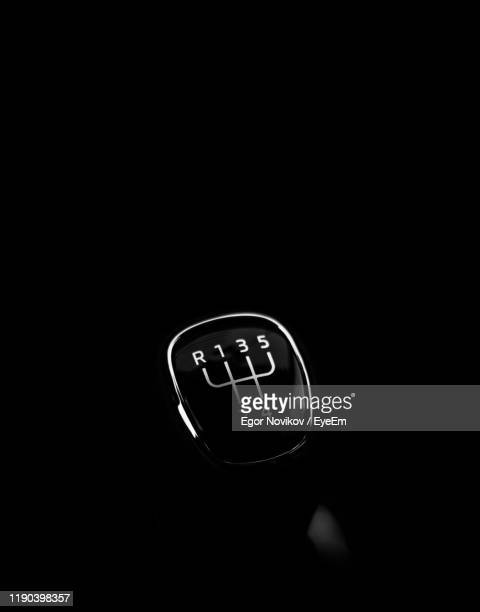 close-up of car gear against black background - gearstick stock pictures, royalty-free photos & images
