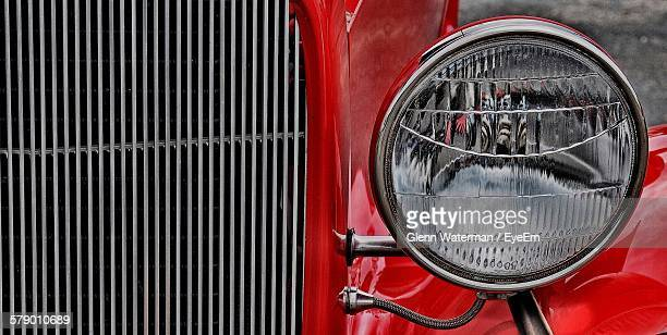 close-up of car headlight - vehicle grille stock pictures, royalty-free photos & images