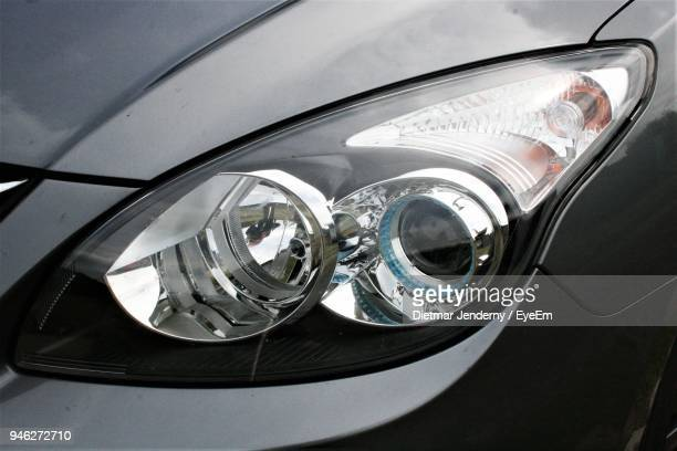 close-up of car headlight - headlight stock pictures, royalty-free photos & images