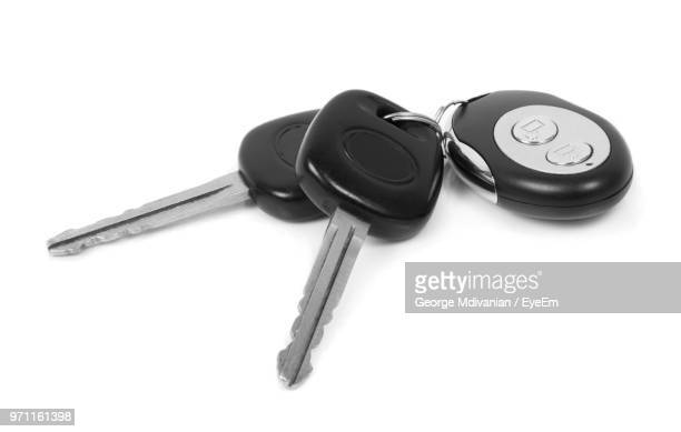 Close-Up Of Car Keys Over White Background