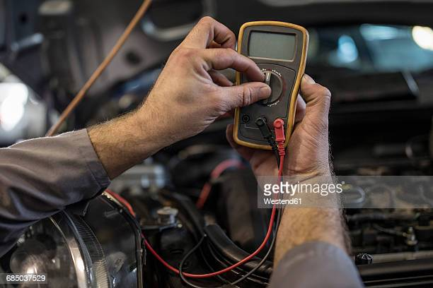 close-up of car mechanic in a workshop using diagnostic equipment - mechatronics stock pictures, royalty-free photos & images