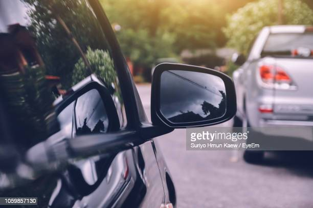 close-up of car on side-view mirror - side view mirror stock photos and pictures