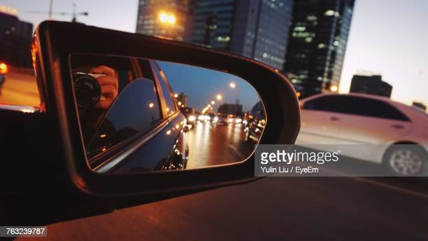 Close-Up Of Car Side-View Mirror On Street At Night