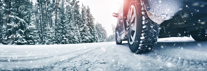 Closeup of car tires in winter on the road 1066670684