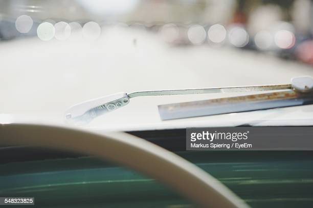 Close-Up Of Car Windscreen Against Blurred Background