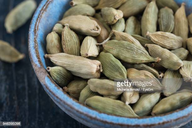 close-up of cardamom in bowl on table - cardamom stock photos and pictures