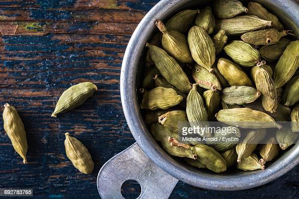 close-up of cardamom in container on table - cardamom stock photos and pictures