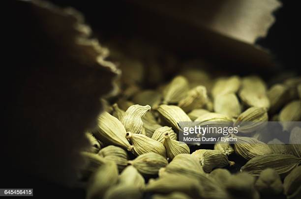 close-up of cardamom in paper bag - cardamom stock photos and pictures