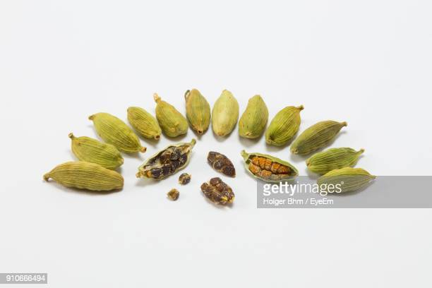 close-up of cardamom over white background - cardamom stock photos and pictures