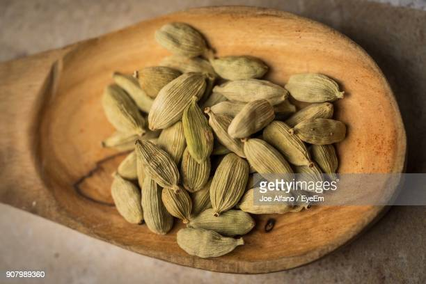 close-up of cardamoms in spoon - cardamom stock photos and pictures