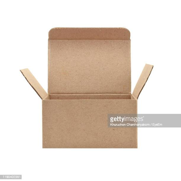 close-up of cardboard box against white background - package stock pictures, royalty-free photos & images