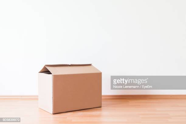 Close-Up Of Cardboard Box On Table Against White Background
