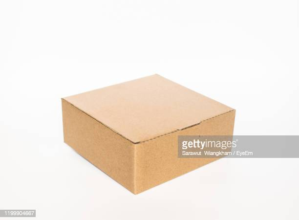 close-up of cardboard box on white background - cardboard box stock pictures, royalty-free photos & images