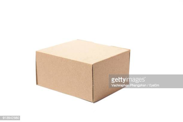 close-up of cardboard box over white background - cardboard box stock pictures, royalty-free photos & images