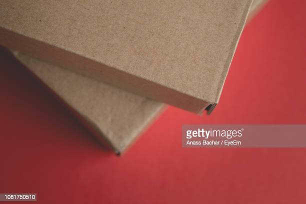 Close-Up Of Cardboard Boxes Against Red Background