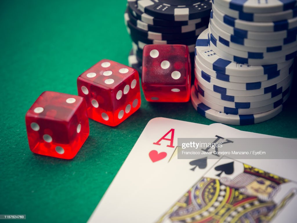 Closeup Of Cards By Gambling Chips And Dices On Casino Table High