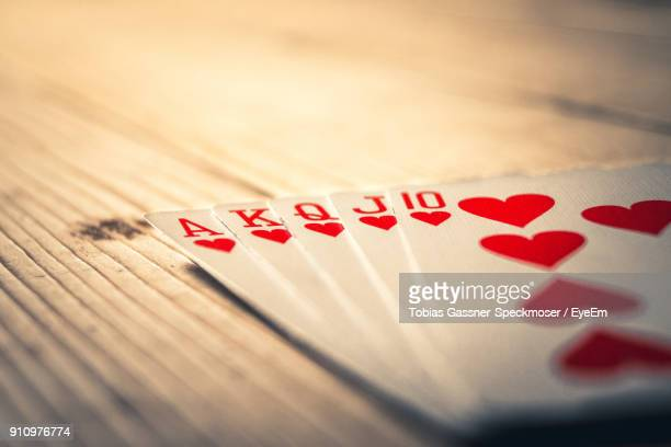 close-up of cards on table - hearts playing card stock photos and pictures