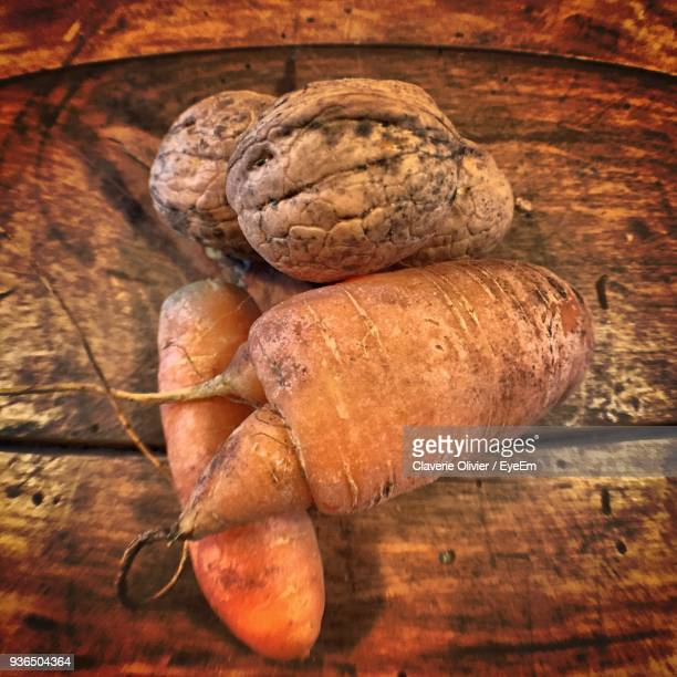 close-up of carrot and nuts on table - hauts de france stock photos and pictures