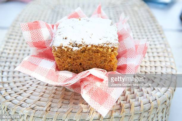 Close-Up Of Carrot Cake On Wicker Table