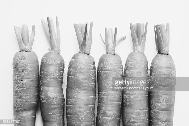 close-up of carrots against white background - black and white vegetables stock photos and pictures