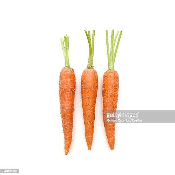 Close-Up Of Carrots Against White Background