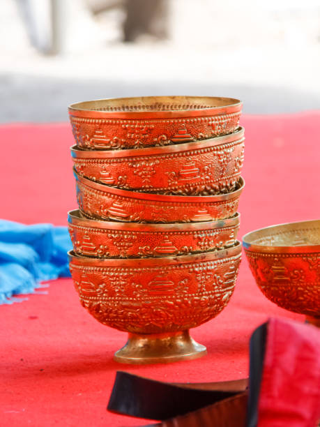 Close-Up Of Carved Bowls On Table In Temple