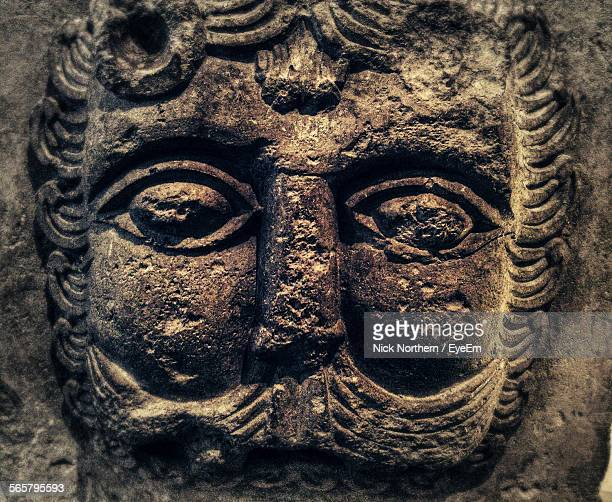close-up of carved human face - human face foto e immagini stock