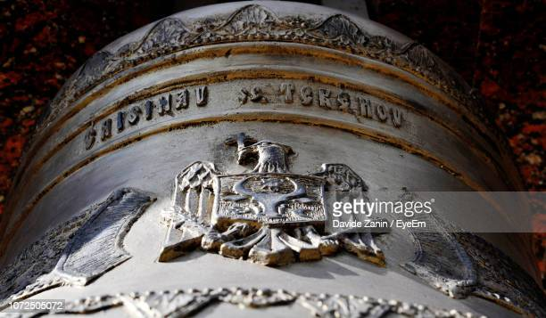 close-up of carving on bell - chisinau stock pictures, royalty-free photos & images